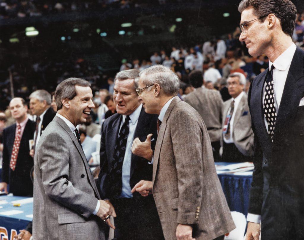 "Roy Williams, Dean Smith, Bill Guthridge, and Matt Doherty during the 1993 ""Final Four"" NCAA tournament."