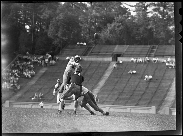 Dick Bunting throwing a pass during 1948 Blue-White game, which may be the first Hugh Morton photographed.  Newspapers articles examined thus far for the two previous Blue-White games do not include photographs, and Morton did not identified the vast majority of his UNC football negatives.