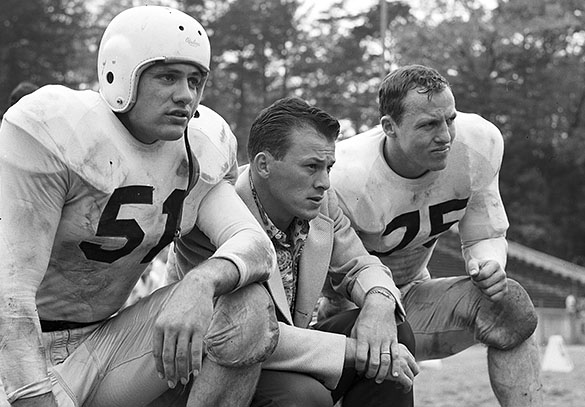 UNC right tackle Bill Kuhn (#51), backfield coach Charlie Justice, and running back John Gaylord (#25). See the photograph above with Kuhn as a freshman, when Justice and Snavely praised his abilities in Wilmington's Morning Star.  (Photograph cropped by the editor.)