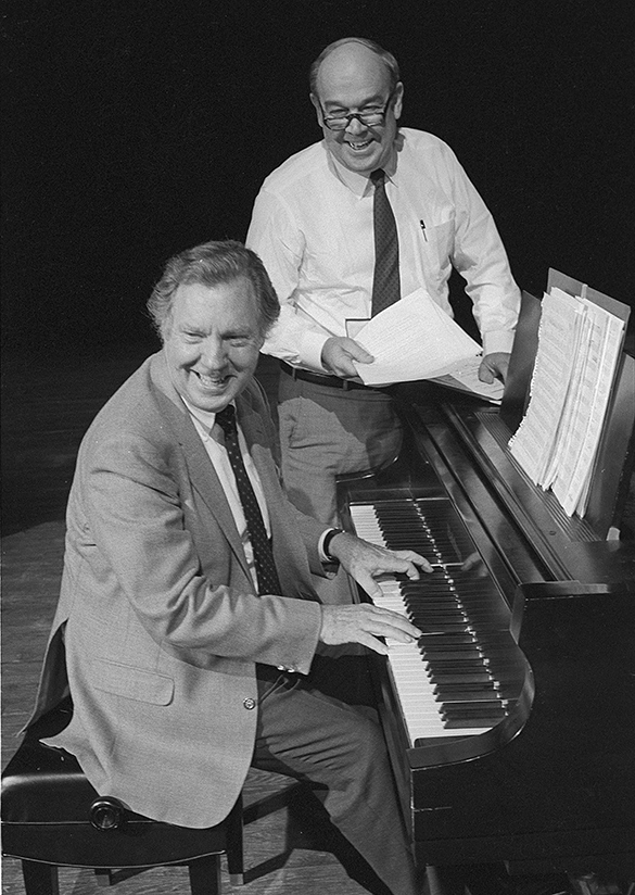 Charles Kuralt (right) and Loonis McGlohon photographed together by Hugh Morton sometime near the debut of their album titled North Carolina Is My Home.  The photograph appeared in the November 1985 issue of The State accompanying an article written by Charles Heatherly.