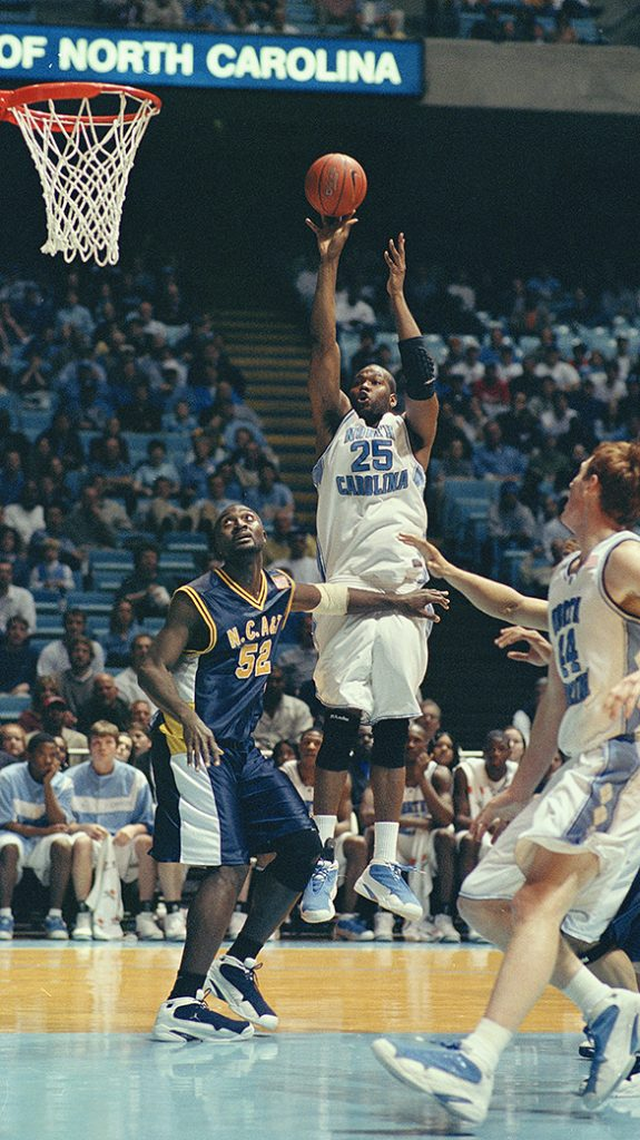 Game-action photograph by Hugh Morton (cropped by the editor)  from the 2001 UNC vs. NC A&T contest.  Who are the players in the photograph?  Please leave a comment below if you know!