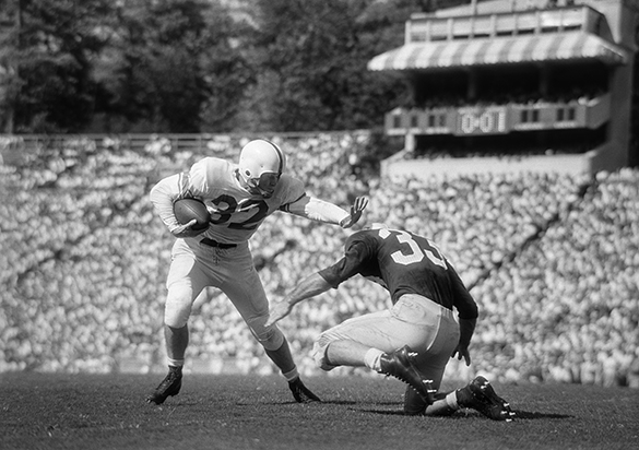 Larry Parker tackling James Meadlock, University of North Carolina vs North Carolina State football game, Kenan Memorial Stadium, Chapel Hill, 25 September 1954.