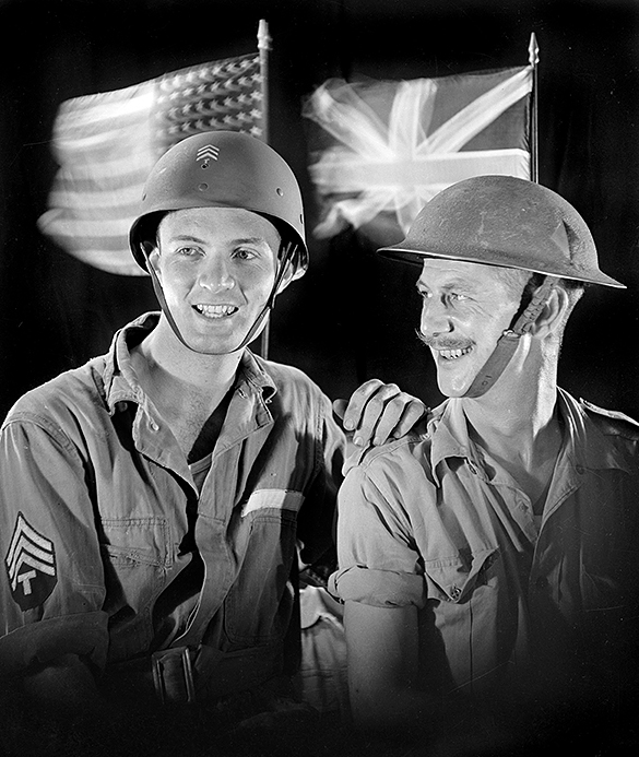 """Hugh Morton (left) with member of the Special British Battery of Royal Artillery—designated as the """"Composite Antiaircraft Artillery Battery""""— that trained at Camp Davis during the summer of 1943."""