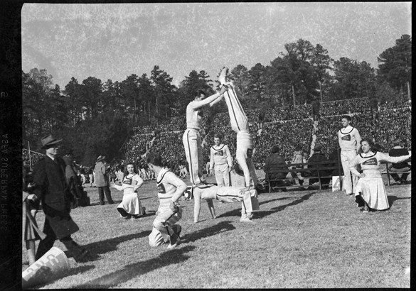 "1940: This photograph (cropped) appears in the 1941 YACKETY YACK with caption, ""Cheerleaders maneuver before Duke-Carolina football game."""