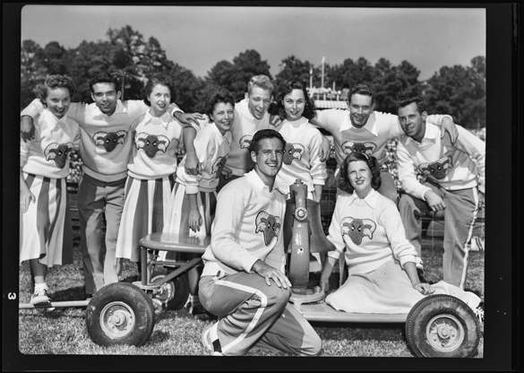 1948 or 1949: UNC-Chapel Hill cheerleaders with Victory Bell after football team defeated Duke. THE CAROLINA GRIDIRON, 15 and 29 October 1949.