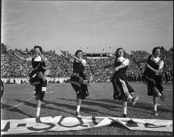 1955: Duke cheerleaders at UNC-Chapel Hill football game versus Duke University at Duke Stadium, Durham, NC.