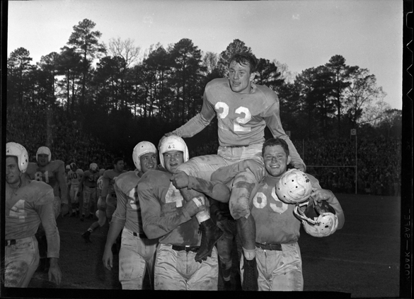 Charlie Justice on shoulders of teammates