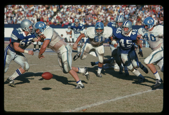1973: UNC-Chapel Hill vs. Duke University football game at Duke's Wallace Wade Stadium, Durham, NC. UNC players: #61 Offensive Guard Billy Newton and #40 Halfback Jimmy Jerome. Duke players: #62 Linebacker Dave Meier, #24 Defensive Safety Buster Cox, #76 Defense Tackle John Ricca, and #45 Linebacker Keith Stoneback.
