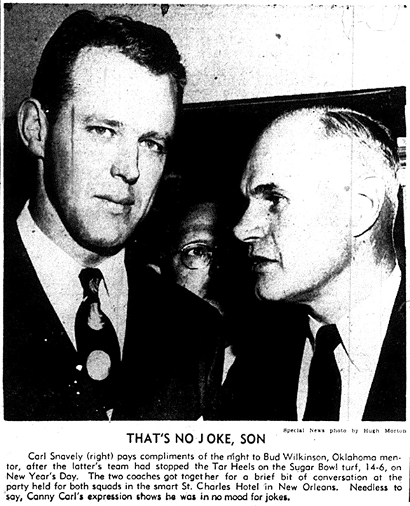 """Special news photo by Hugh Morton"" as it appeared in the Charlotte News on January 4th, 1949. The caption reads, ""Carl Snavely pays compliments of the night to Bud Wilkinson, Oklahoma mentor, after the latter's team had stopped the Tar Heels on the Sugar Bowl turf, 14-6, on New Year's Day. The two coaches got together for a brief bit of conversation at the party held for both squads in the smart St. Charles Hotel in New Orleans. Needless to say, Canny Carl's expression shows he was in no mood for jokes."""