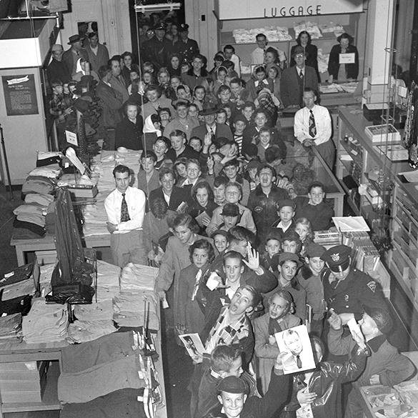 Crowd of children waiting for Charlie Justice for an autograph. Photograph by Edward J. McCauley.