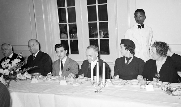 Members of the head table during the International Relations Club dinner held before William C. Bullitt's speech. Left to right are Josephus Daniels, Bullitt, IRC president Manfred Rogers, Frank Porter Graham, and two unidentified women. This cropping is almost the same as the photograph was reproduced in the Yackety Yack, with just a touch more taken off the bottom.