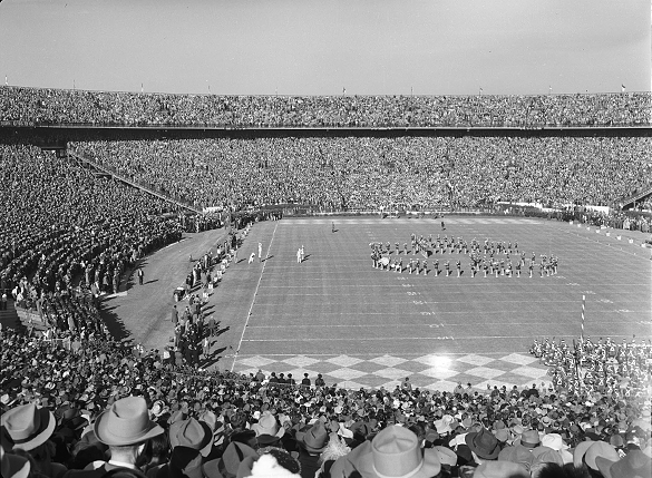 The University of North Carolina Marching Band performing on the field inside expansive Tulane Stadium during halftime of the 1949 Sugar Bowl in New Orleans.
