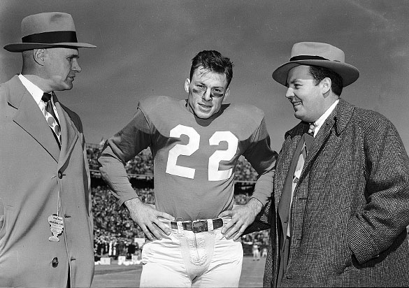 UNC Head Football Coach Carl Snavely, UNC tailback Charlie Justice, and ABC Radio play-by-play announcer Harry Wismer prior to the start of the 1949 Sugar Bowl.