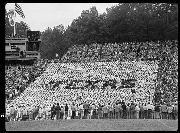 """A technicolor team of some 2,185 students"" is how The Daily Tar Heel for 24 September 1948 described the stadium sections where Head Cheerleader Norm Sper introduced ""card stunts"" for the first time during a regular season game. Sper brought the crowd participation displays to Carolina from the west coast. He first used the cards earlier in the years during UNC's 1948 Blue-White spring intrasquad practice game. You can see the display from the Blue-White game at https://blogs.lib.unc.edu/morton/index.php/2015/04/a-tar-heel-tradition-in-blue-white/."