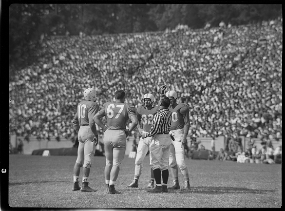 Opening coin toss before the Kenan Stadium contest between North Carolina and Texas. The Texas player wearing #32 is Tom Landry, who would eventually coach the Dallas Cowboys of the national Football League for twenty-nine years.