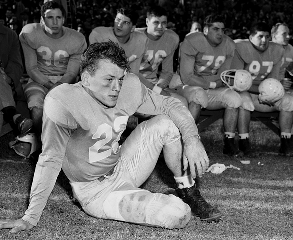 "This photograph ran in The High Point Enterprise with the caption, ""DEJECTED—Two minutes before the end of the the Sugar Bowl last Saturday this remarkable picture of Charlie Justice was snapped in front of the Tar Heel bench. The expression on the dejected ""Choo-Choo's"" face tells a whole story of an unsuccessful afternoon of football for one great All-American."" The photograph as presented here is cropped by blog editor with a slightly different composition as published in The High Point Enterprise. For photographers who use the ""Rule of Thirds,"" the upper third line runs straight through Justice's eyes."