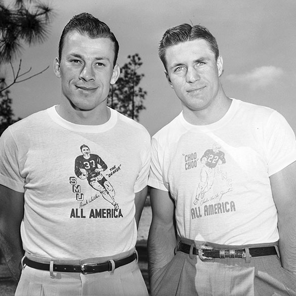 "UNC All America football player Charlie ""Choo Choo"" Justice (L) and SMU All America Doak Walker posing together, each wearing t-shirts celebrating the other's All America honors."