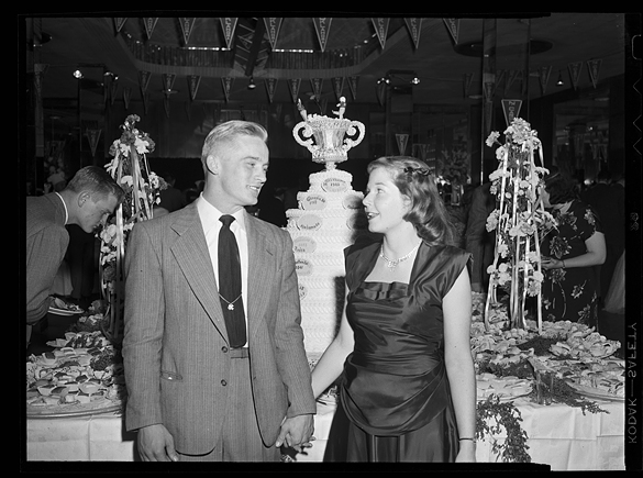 An unidentified couple, presumably a UNC player and his girl friend or spouse, at a party for UNC and Oklahoma. ( Negative by Hugh Morton.)