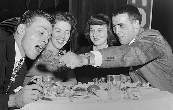 Charlie Justice, Sarah Justice, Mrs. Chan Highsmith, and Chan Highsmith during a 1949 Sugar Bowl party in New Orleans.