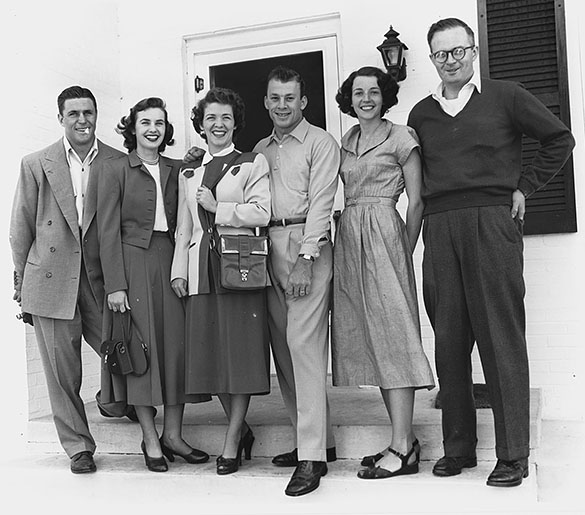 SMU All America football player Doak Walker, Doak's wife Norma, Sarah Justice, UNC All America football player Charlie Justice, Julia Morton, Hugh Morton, on the stoop of the Mortons' home in Wilmington. Walker and Justice were participants in the 1950 Azalea Festival.