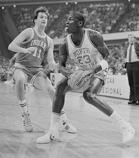Indiana's Dan Dakich guards UNC's Michael Jordan during the 1984 NCAA East Regional Semifinal in Atlanta, Georgia. Indiana head coach Bob Knight watches the action in the background. In those days UNC wore Converse shoes. (Hugh Morton photograph, cropped by the author.)