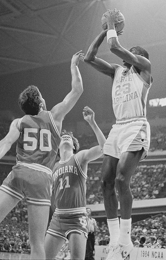 Michael Jordan takes a jump shot during the 1984 NCAA East Regional semifinal. (Hugh Morton photograph, cropped by the author.)