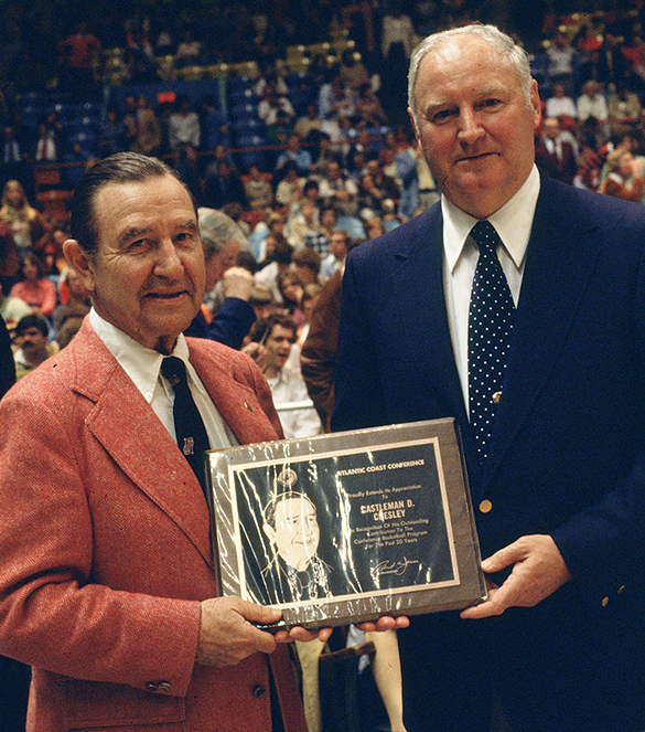 At the 1977 Atlantic Coast Conference Basketball Tournament, Castleman D. Chesley received a plaque from ACC Commissioner Bob James in recognition of Chelsey's vision in establishing the ACC Television Network. (Photograph cropped by the editor.)