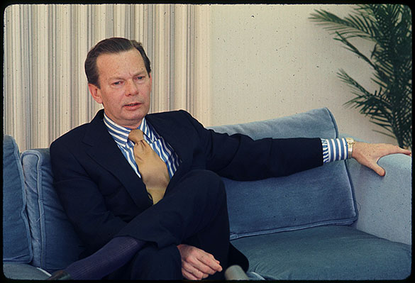 Newscaster David Brinkley sitting before/after a news conference. The slide mount date is February 1971.
