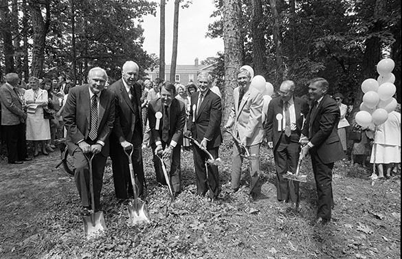 May 13, 1987 groundbreaking ceremony for the George Watts Hill Alumni Center on the UNC-Chapel Hill campus. (L to R): Ralph Strayhorn, fund raising chairman; George Watts Hill; Doug Dibbert, General Alumni Association Executive Director; Robert C. Eubanks, Board of Trustees Chairman; Tom Lambeth, chairman of the area campaigns; Chancellor Emeritus Christopher C. Fordham III; and UNC Chancellor Paul Hardin.