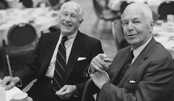 Frank H. Kenan (left) and George Watts Hill Sr. (right) at an unidentified event, probably at UNC-Chapel Hill. (Photograph cropped by blog editor.)