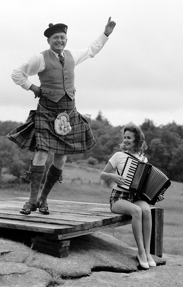 Donald MacDonald dancing the Highland Fling while an unidentified woman plays accordion at the first Highland Games in 1956 near Grandfather Mountain, N. C. (Hugh Morton photograph, cropped by the editor.)