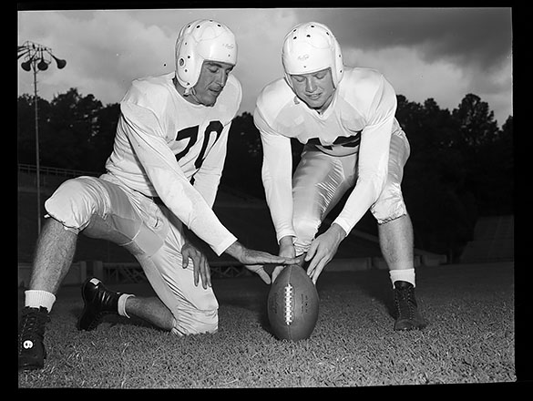 Hugh Morton photograph of UNC fullback Hosea Rodgers (#70) and left end Bob Cox (#49), late 1940s.