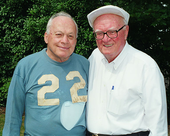 Charlie Justice standing with Hugh Morton. Justice is wearing the #22 jersey recovered in November 1948 by UNC President C. D. Spangler during a UNC-Virginia football game. This photograph dates from the late 1990s to early 2000s.