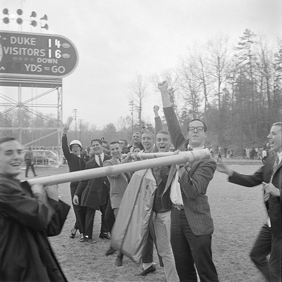 With the game in hand, UNC fans took the goal post into their own hands. Scan of Hugh Morton's negative, shown full frame, follows the frame shown above.  There are no identified game-action negatives in the Morton collection.
