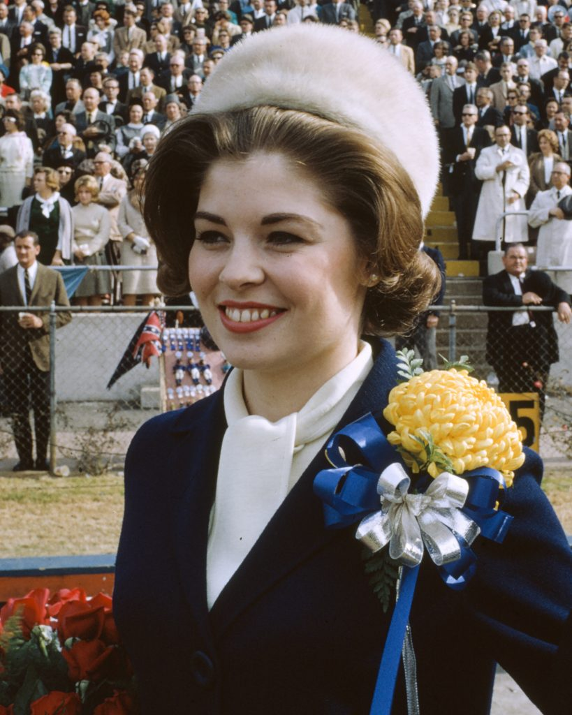 This unidentified woman appears to be 1964 Miss America Donna Axum, probably during pregame festivities. Photograph by Hugh Morton, cropped by the editor.