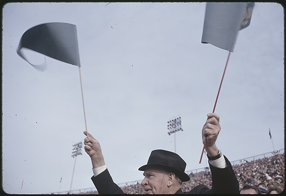Luther Hodges waves two UNC banners during the 1963 Gator Bowl.