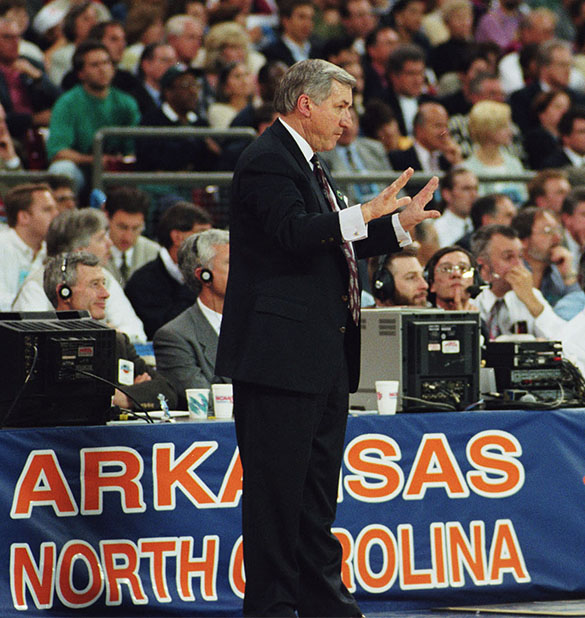 UNC head basketball coach Dean Smith on sidelines during national semifinal match-up against Arkansas in the Kingdome in Seattle, Washington on April 1, 1995. (Hugh Morton photograph cropped by the author.)