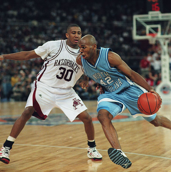 UNC's Jerry Stackhouse guarded by Arkansas' Scotty Thurman during their 1995 national semifinal game played on April 1, 1995 in Seattle's Kingdome. (Photograph by Hugh Morton, cropped by the author.)