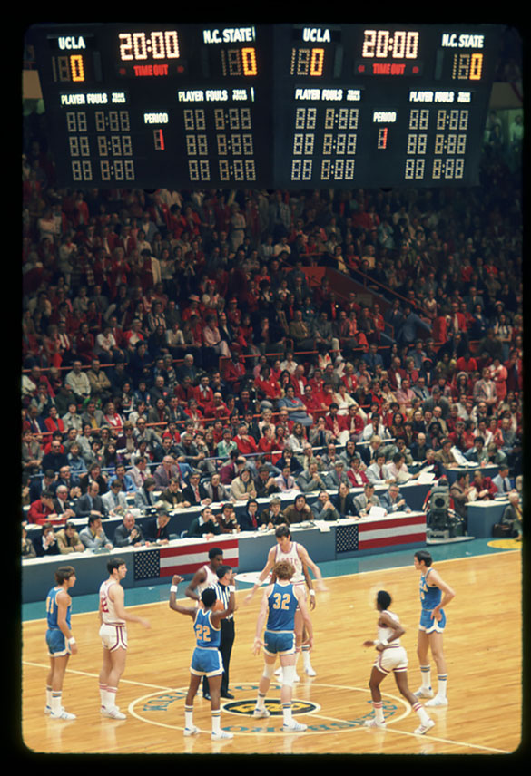 A moment before tip-off of the 1974 NCAA National Semifinal basketball game at Greensboro Coliseum, Greensboro, NC. North Carolina State University played the University of California at Los Angeles, March 23, 1974.