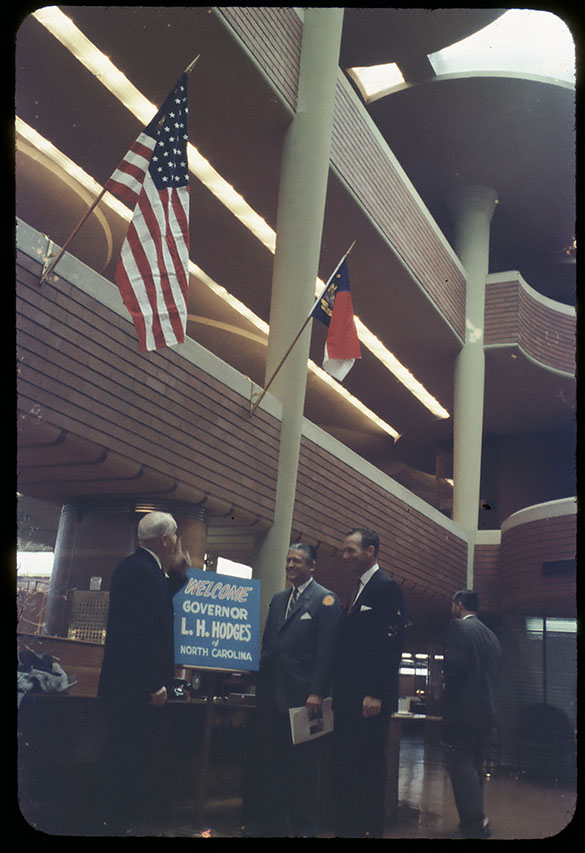 "Until now, the description of this photograph was ""NC Governor Luther H. Hodges being greeted by men, probably at a hotel. Taken on ""industry hunting"" trip with Hodges administration, circa 1960, possibly to Chicago or New York."" There are twenty-two slides in the collection with similar captions, now known to be erroneous."