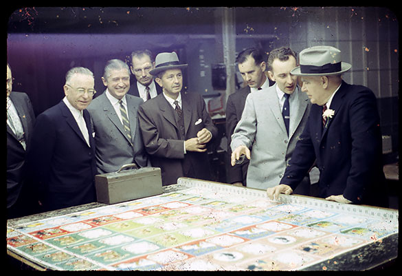 "Luther Hodges and group, probably during its tour in Racine, Wisconsin. As slide 21 of 22, it's likely at the Case Corporation plant, but the entirety of their tour has not yet been researched. Slide 22 has a hand-written label ""Industry Hunting."""
