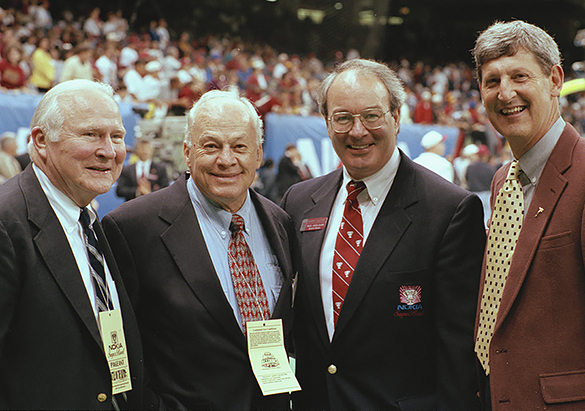 THREE TAR HEELS—Ralph Strayhorn Jr., Charlie Justice, Sugar Bowl CEO Paul Hoolahan, with an unidentified man gathered on the sidelines before the 1997 Sugar Bowl.