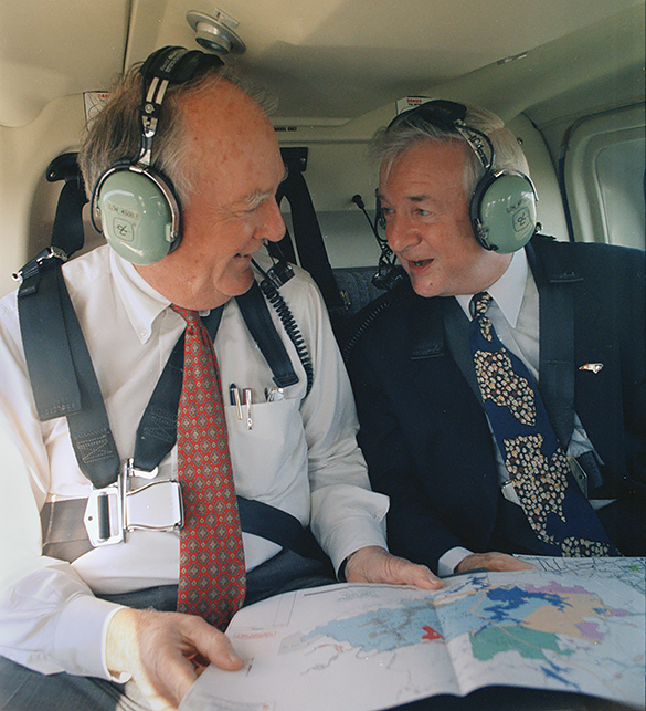 Chairman of Duke Power Company, Bill Grigg, and Governor Jim Hunt during a flyover to view the land that would become Gorges State Park, April 1997. (Hugh Morton photograph, cropped by the author.)