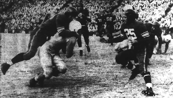 "Hugh Morton's photograph published in the November 27, 1950 issue of the Charlotte News with the caption, ""Dick Bunting fights his way to the Duke 22 in the fourth quarter of the North Carolina game at Chapel Hill, but Blaine Earon is there to slam him down.  This threat, like five others, failed.""  A search for this negative in the Morton collection did not turn up the negative."