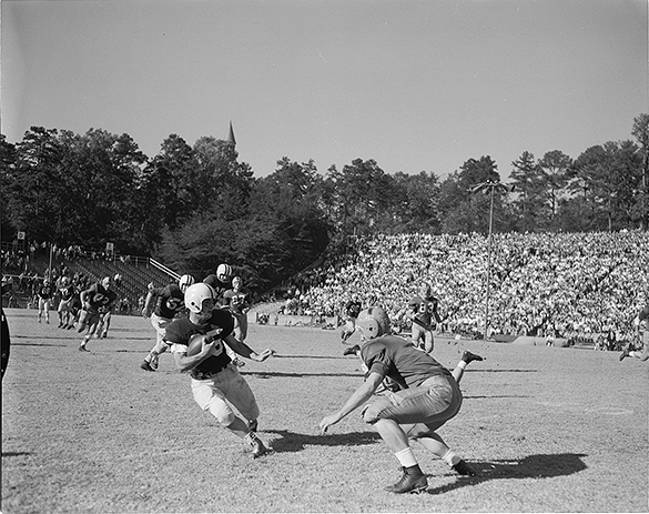 The Charlotte News published this photograph tightly cropped on the runner and soon-to-be tackler with the caption, 'KEN KELLER . . . gains 12 for UNC against Notre Dame (Hugh Morton Photo.)""