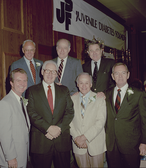"Dignitaries featured during the Fifth Annual JDF Roast: (back row, left to right): Bill Hensley, Orville Campbell, Bill Friday; (front row, left to right): Woody Durham, Art Weiner, Charlie Justice, John ""Buck"" Fraley. Photograph by Hugh Morton, cropped by the editor."
