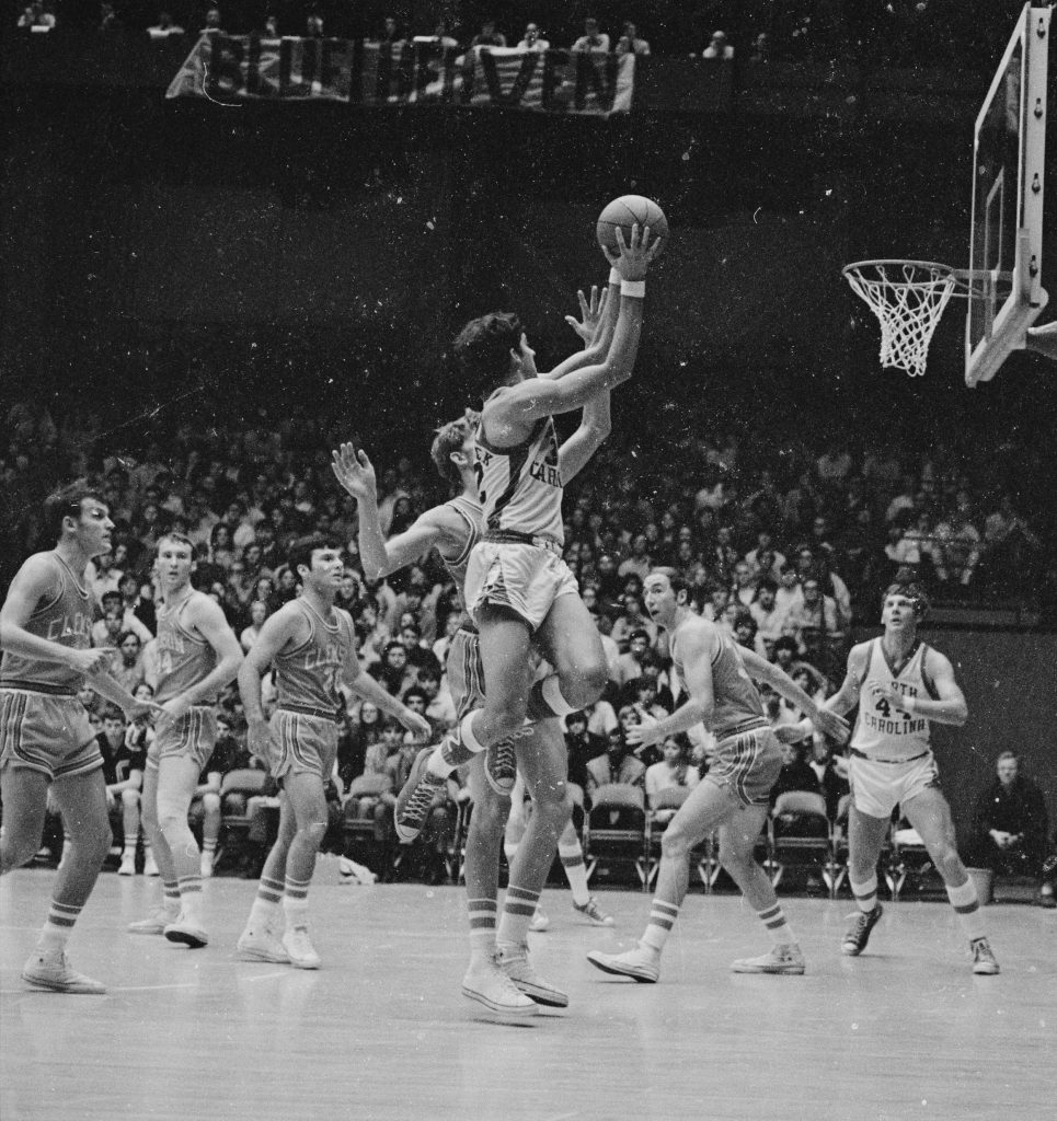 UNC's Dave Chadwick drives for a layup while Clemson players and Blue Heaven fans watch the action during the teams' 1971 pairing.