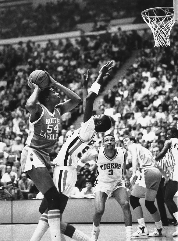 """UNC's Warren Martin #54 with the ball; UNC's Joe Wolf #24 in background during the 1986 Clemson at UNC matchup, their first in the """"Dean Dome."""""""