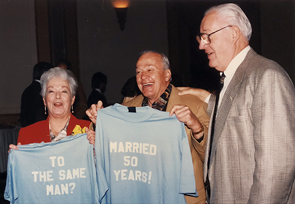 Sarah and Charlie Justice holding tee shirts, with Art Weiner