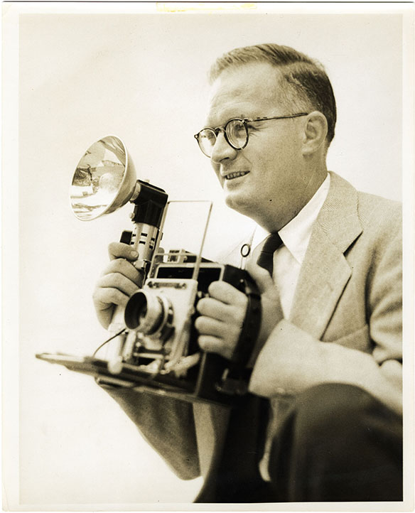 Hugh Morton holding Speed Graphic camera